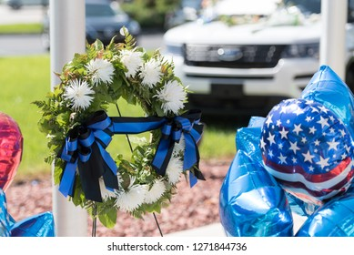 Law Enforcement police officer funeral wreath for memorial with back and blue ribbon