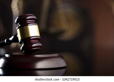 Law firm concept. Gavel, books, clock, balance, statue of justice.