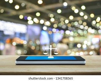 Law flat icon on modern smart mobile phone screen on wooden table over blur light and shadow of shopping mall, Business legal service online concept