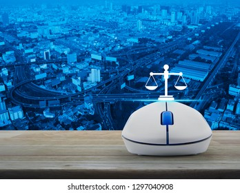 Law flat icon with wireless computer mouse on wooden table over city tower, street, expressway and skyscraper, Business legal service online concept