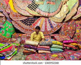law garden night market, Gujarat, India – April 1, 2019: merchant with traditional dresses smiling for the camera on april 1, 2019 at the law garden night market, Gujarat, India.