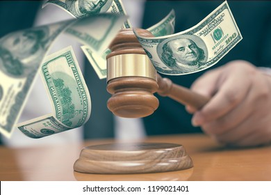 Law Judge with Gavel hummer of lawyer for justice or bit purchasing auction and flying dollae money inlegal Law injustice Concept.