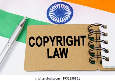 Law and justice concept. Against the background of the flag of India lies a notebook with the inscription - COPYRIGHT LAW