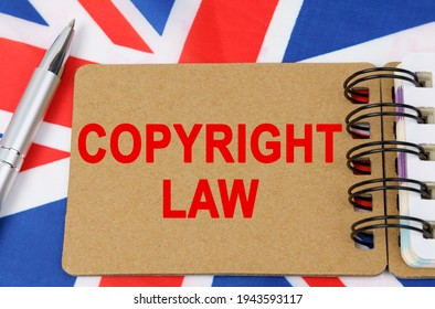 Law and justice concept. Against the background of the flag of Great Britain lies a notebook with the inscription - COPYRIGHT LAW