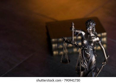 Law and justice concept background. Themis and books.