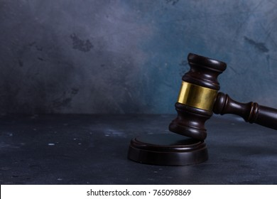 Law and justice concept - law gavel on gray background