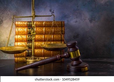 Law and justice concept - law gavel with scale and row of books, retro toned