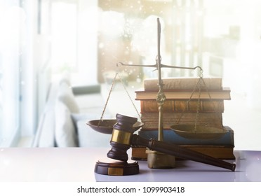 Law and justice concept - law gavel with scale and row of books on white abstract background