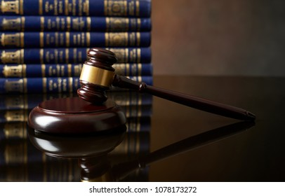 Law and Justice concept Judge hammer and books with reflection