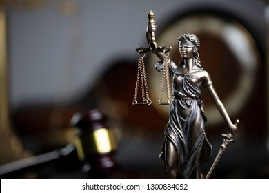 Law and justice concept. Judge's gavel, scales, hourglass, vintage clock, books.
