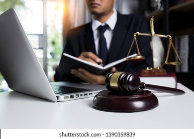 Law and justice concept. lawyer working with laptop report the case on table in modern office.