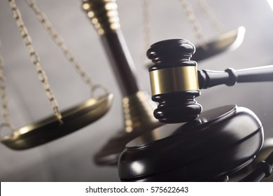 Law and justice concept. Mallet of a judge. Scales of justice. Gray background, place for typography