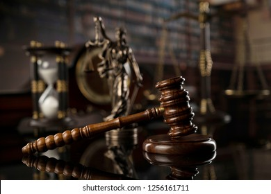 Law and justice concept. Old library, gavel, scales, hourglass, books