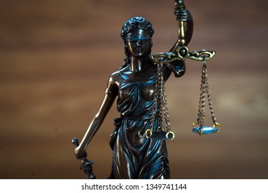 Law and Justice concept on wooden background