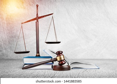 Law and justice concept, wooden gavel and bronze scale