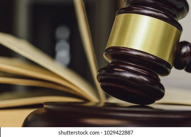 Law and Justice. Judge gavel and book in blurred background