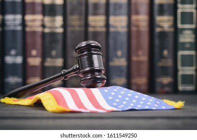 Law and Justice, Judge Gavel and United States of America flag on a black wooden background.