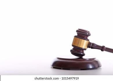 Law, justice, judge's hammer, auction. White background. Copy space for text.