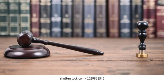 Law and Justice, Legality concept, Judge Gavel and Notary seal on a wooden background, Law library concept.
