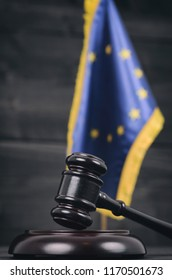 Law and Justice, Legality concept, Judge Gavel and European Union flag on a black wooden background.