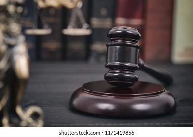Law and Justice , Legality concept, Judge Gavel and Lady Justice on a black wooden background.