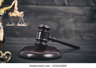 Law and Justice, Legality concept, Judge Gavel, Scalesof Justice and Lady Justice on a black wooden background.