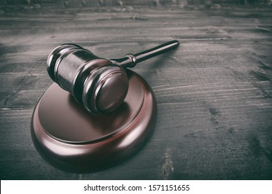 Law and Justice, Legality concept, Judge Gavel on a black wooden background.