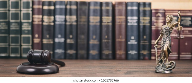 Law and Justice, Legality concept, Lady Justice, Scales of Justice and Judge Gavel on a wooden background, Law library concept.