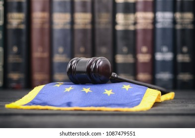 Law and Justice, Legality concept, Law library, Judge Gavel and European Union flag on a black wooden background.