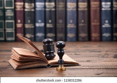 Law and Justice, Legality concept, Notary Seal, Judge Gavel and Law book on a wooden background.
