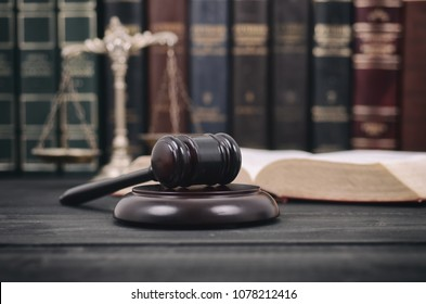 Law and Justice, Legality concept, Scales of Justice and Judge Gavel on a black wooden background.