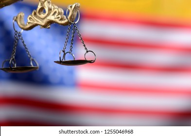 Law and Justice, Legality concept, Scales of Justice, Justitia, Lady Justice in front of the American flag in the background.