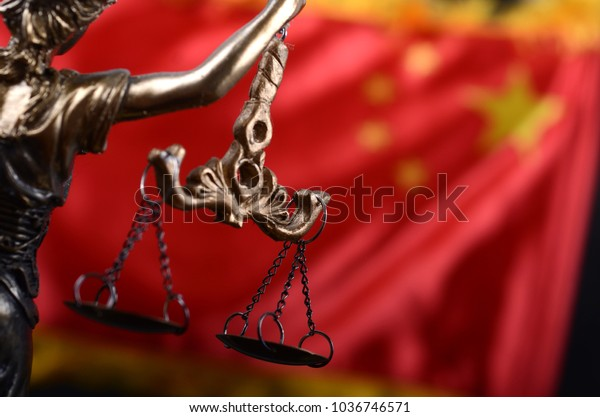 Law and Justice, Legality concept, Scales of Justice, Justitia, Lady Justice in front of the flag of China in the background.