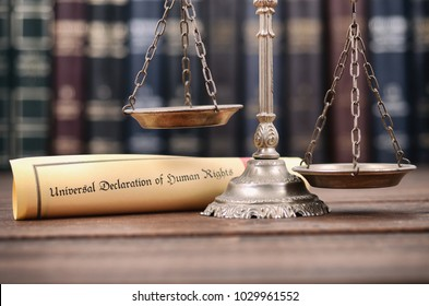 Law and Justice, Scales of Justice, Universal declaration of human rights on a wooden background, human rights concept.