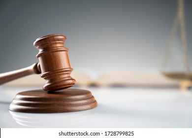Law and justice symbols. Bokeh background.