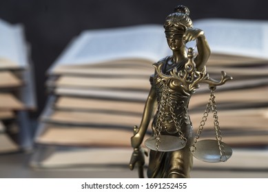 Law and Justice Symbols with law books on background. Law concept image.