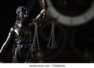 Law and Justice symbols on black background