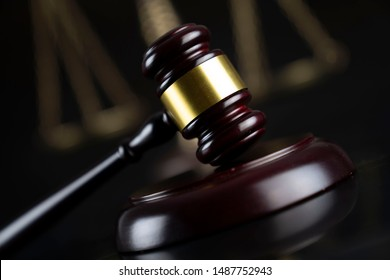 Law and justice symbols on dark background.