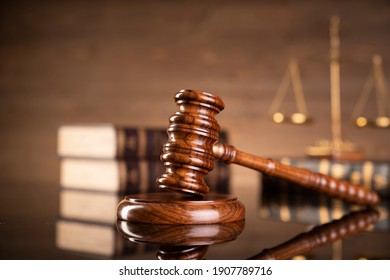 Law and justice. Wooden judge gavel, close-up view.