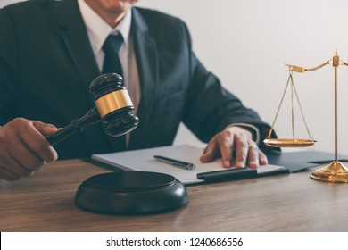 Law, lawyer attorney and justice concept, male lawyer or notary working on a documents and report of the important case in the law firm.