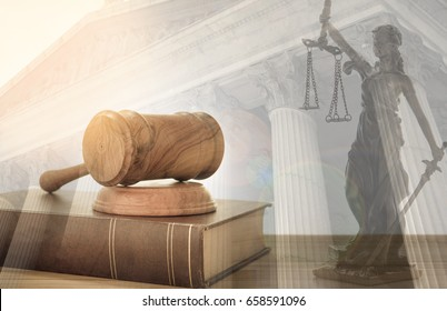 Law, legal concept. Judge gavel on law books with statue of justice and court government background.