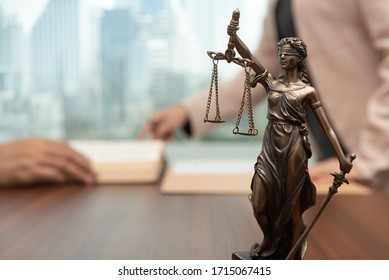 law legal concept. statue of justice with judge consult or lawyer meeting with client at law firm.