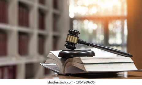 Law, legal judgement, legistration, litigation, court verdict, judicial system and civil right and social justice concept with judge gavel on law textbook in attorney law firm, lawyer business office