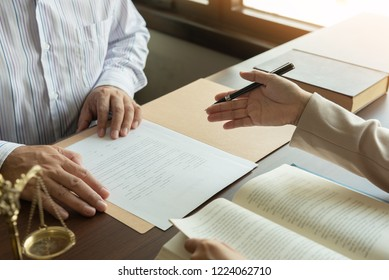 law and legal services concept. judge consult and women lawyer or attorney having team meeting with client at legal firm.