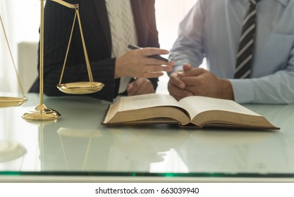 Law and Legal services concept. Lawyer and attorney having team meeting at law firm.