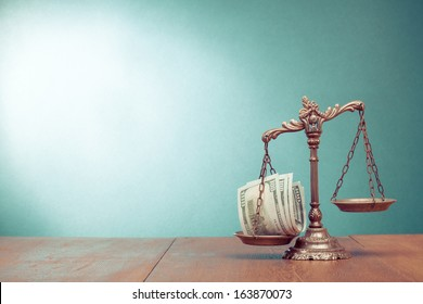 Law scales and cash money on table concept photo