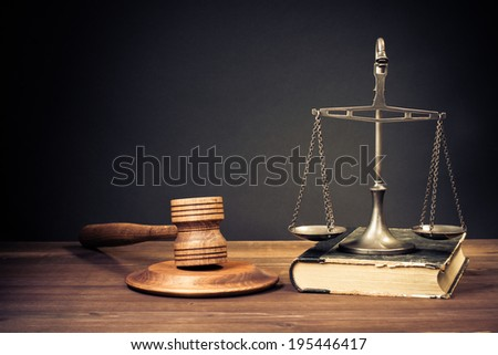 Law scales, judge gavel, old book. Symbol of justice