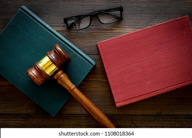 Law student concept. Judge gavel and vintage books on dark wooden background top view