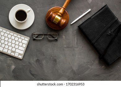 Law student office desk - gavel, computer, notebook - grey, top view copy space