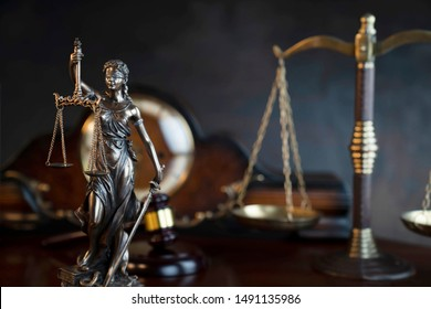 Law symbols composition on vintage table.